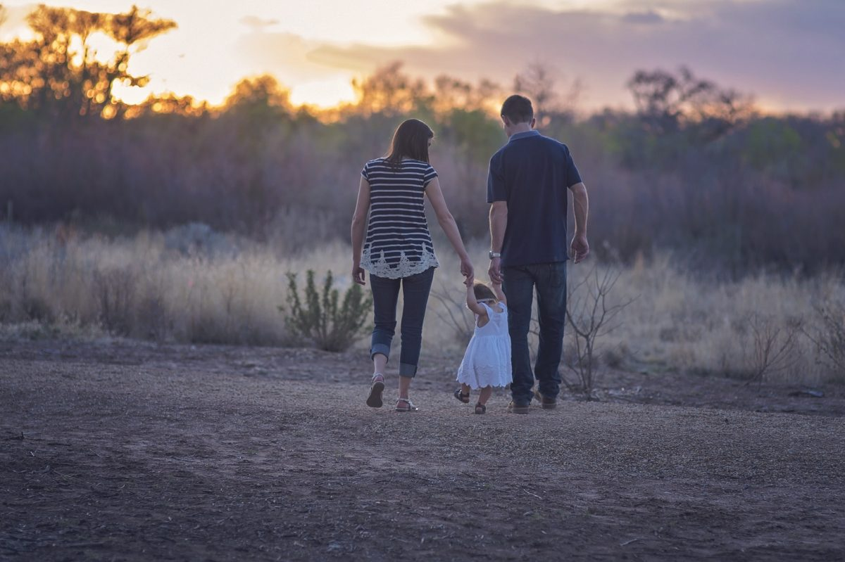 A family goes on a walk together.