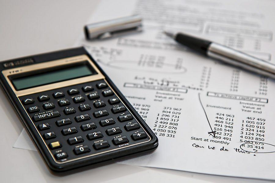 black calculator sitting on paper