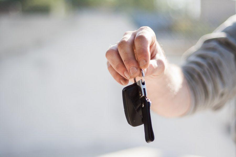 Holding new car keys