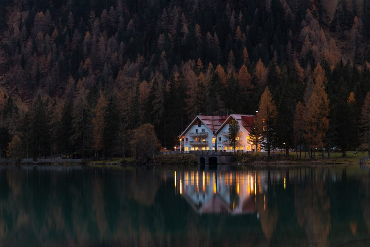 Early morning house on edge of water