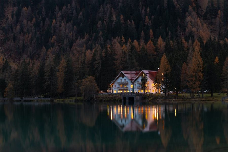 A house on the water during the evening.