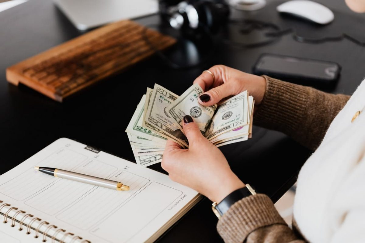 A business counts its money,