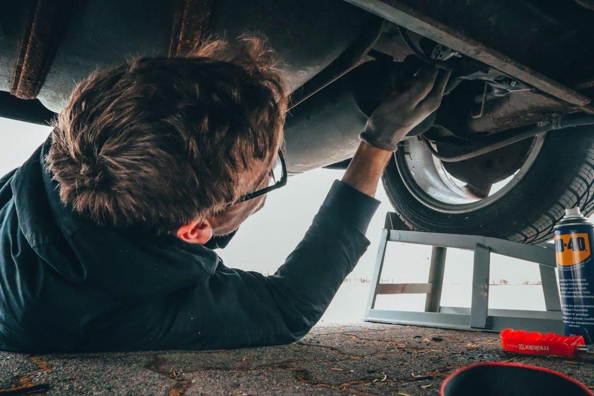 A man fixes his car.