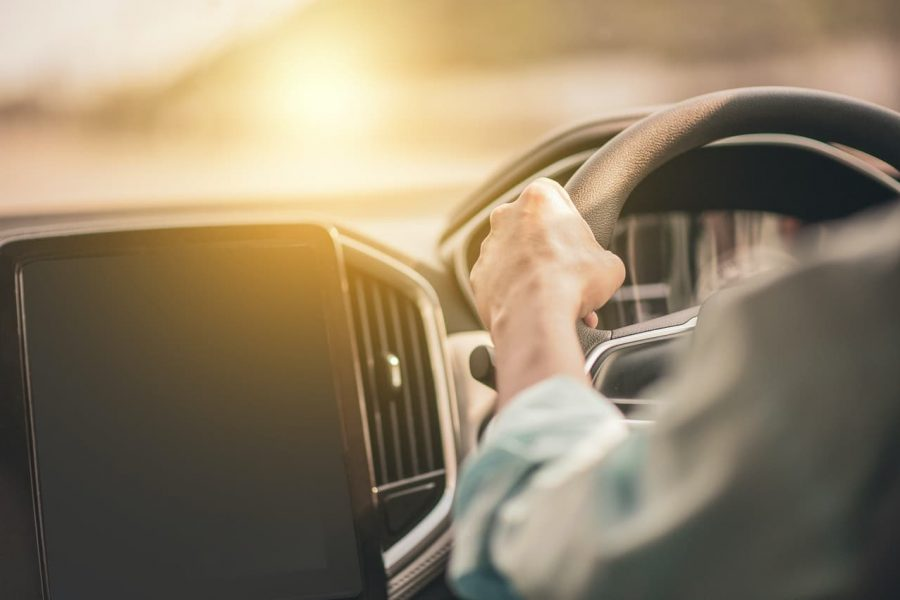 An individual drives during the day.